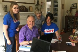 Hart's campaign team (with his wife behind him to the right).