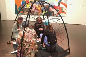 Le Courtois hosting a conversation in the pod at the Denver Art Museum..